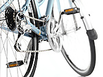 Detail closeup of a classic light blue womens bicycle isolated on white background