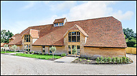 BNPS.co.uk (01202 558833)<br /> Pic: Strutt&amp;Parker/BNPS<br /> <br /> The barn after the conversion.<br /> <br /> These stark before and after pictures show the remarkable transformation of a dilapidated barn into a luxurious home worth &pound;1.25million. <br /> <br /> The ramshackle 16th century structure on a derelict farm was in a state of near ruin before developer Mark Parmenter undertook the colossal project - his first ever barn conversion. <br /> <br /> Mr Parmenter, 60, immediately identified the magnificent 400-year-old beams as the centrepiece of his project. <br /> <br /> Despite the decrepit exterior, which pictures show to have been rusty and crumbling, he was pleasantly surprised to find the inside in remarkably good condition. <br /> <br /> The property is now on the market with Strutt &amp; Parker.