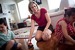 Carrie Miskawi plays with her children at their Folsom, California home, March 14, 2013. Miskawi and her family would like to move to a bigger home, but their struggling to find something on the market.