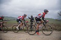 Sean de Bie (BEL/Lotto-Soudal) putting in a serious effort in service of Tim Wellens (BEL/Lotto-Soudal) at the front in order to catch the escape group ahead<br /> <br /> 11th Strade Bianche 2017