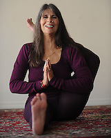 NWA Democrat-Gazette/ANDY SHUPE<br /> Louise Ellis, an Ashtanga yoga teacher who lives in India and Fayetteville, poses Friday, Jan. 15, 2016, in her studio in Fayetteville. Ellis is one of the few women to have been certified by guru Sri K Pattabhi Jois to teach Ashtanga Vinyasa Yoga.