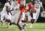 Mississippi quarterback Barry Brunetti (11) runs against Mississippi State at Vaught Hemingway Stadium in Oxford, Miss. on Saturday, November 24, 2012. Mississippi won 41-24. (AP Photo/Oxford Eagle, Bruce Newman).