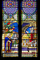 Medieval Gothic stained glass window showing  scenes from the Martyrdom of Saint Denis.The  Cathedral Basilica of Saint Denis ( Basilique Saint-Denis ) Paris, France. A UNESCO World Heritage Site.. The Gothic Cathedral Basilica of Saint Denis ( Basilique Saint-Denis ) Paris, France. A UNESCO World Heritage Site.. The Gothic Cathedral Basilica of Saint Denis ( Basilique Saint-Denis ) Paris, France. A UNESCO World Heritage Site.. The Gothic Cathedral Basilica of Saint Denis ( Basilique Saint-Denis ) Paris, France. A UNESCO World Heritage Site.