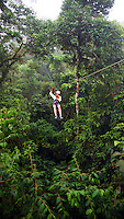 Woman riding zip-line in Coasta Rica
