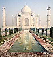 Reflection of Taj Mahal in a pool flanked by gardens and walkways. (Photo by Matt Considine - Images of Asia Collection)