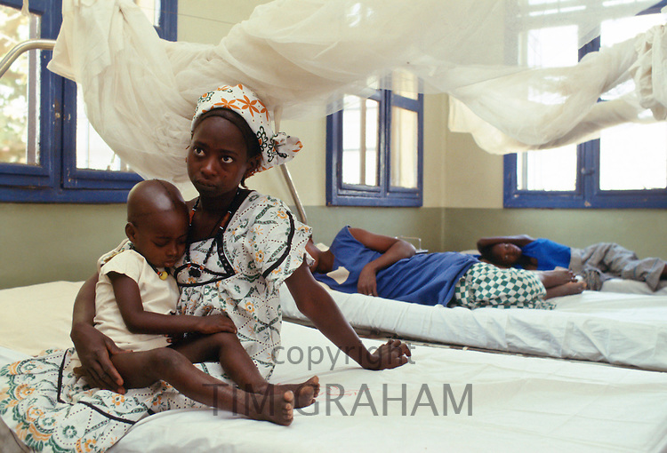 A young mother and her child in Basse Health centre, Gambia
