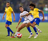 USWNT midfielder (11) Carli Lloyd closely marks Brazilian captain (4) Tania while playing for the gold medal at Workers' Stadium.  The USWNT defeated Brazil, 1-0, during the 2008 Beijing Olympic final in Beijing, China.
