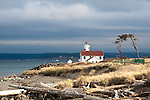 Pt. Wilson Lighthouse, Strait of Juan de Fuca, near Port Townsend, Washington.  Established in 1879, the lighthouse is within Fort Worden State Park.  The fort, now decommissioned, formed part of a triad of gun emplacements constructed in the 1890's to protect Puget Sound. k Fort Flagler on Marrowstone Island and Fort Casey on Whidbey Island comprise the other two points of the triangle.  Excellent camping and a boat launch flank the point.
