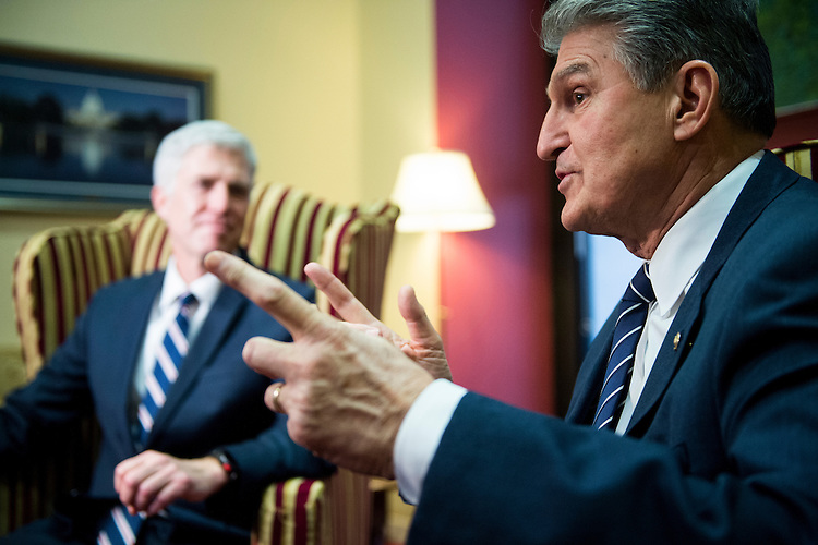 UNITED STATES - FEBRUARY 1: Sen. Joe Manchin, D-W. Va., right, meets with President Donald Trump's nominee for the Supreme Court Judge Neil Gorsuch, in his office on Wednesday, Feb. 1, 2017. (Photo By Bill Clark/CQ Roll Call)