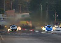 Jun 3, 2016; Epping , NH, USA; NHRA funny car driver Matt Hagan (left) races alongside John Force during qualifying for the New England Nationals at New England Dragway. Mandatory Credit: Mark J. Rebilas-USA TODAY Sports