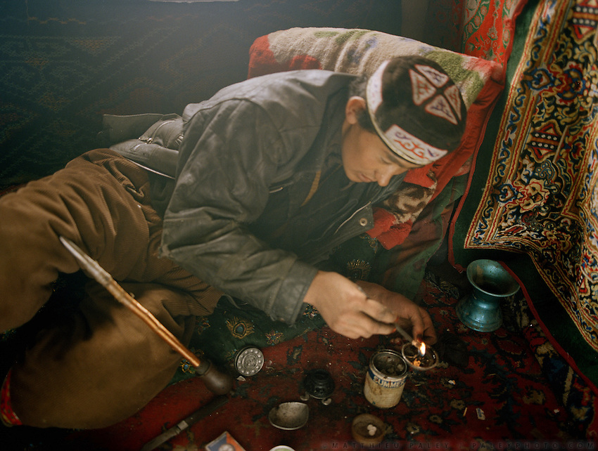 Noor Ullah, another one of the Khan's son, smokes opium 3 times a day, each session is about 1 hour..Opium users inside Ooroon Boi's house, son of the Khan. Winter expedition through the Wakhan Corridor and into the Afghan Pamir mountains, to document the life of the Afghan Kyrgyz tribe. January/February 2008. Afghanistan