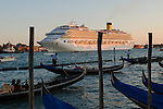 Venice Italy 2009. Cruise ship leaving having spent a day in Venice. Canal Canale de Giudecca. <br /> <br /> Venice is sinking under the weight of 20 million visitors a year. Only 30% of Venice's visitors stay overnight the rest stay out of town or on their cruise ships.