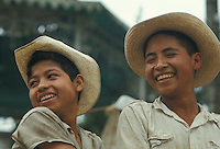 Mexico, Puebla State, Indian boys laughing at market in small town: Cuetzalan.