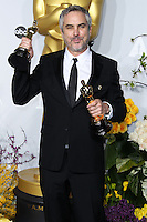 HOLLYWOOD, LOS ANGELES, CA, USA - MARCH 02: Alfonso Cuaron at the 86th Annual Academy Awards - Press Room held at Dolby Theatre on March 2, 2014 in Hollywood, Los Angeles, California, United States. (Photo by Xavier Collin/Celebrity Monitor)