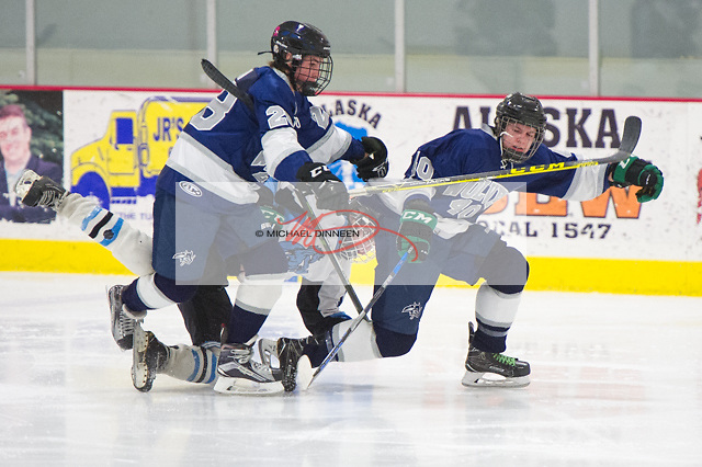 Eagle River's Alden Burton and Logan Rachow get tangled up with Chugiak's Daniel Casey, center, during the Mustang's 5-2 win at the McDonald Center Saturday, January 28, 2017.  Photo for the Star by Michael Dinneen
