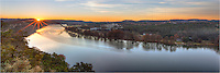 The sun rises over Pennybacker Bridge (also know as the 360 Bridge) on a cool Autumn morning. In the distance is the Austin Skyline. Beneath Pennybacker Bridge flows the Texas version of the Colorado River.