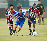 CARSON, CA – SEPTEMBER 19: KC Wizard midfielder Ryan Smith (11)  splits Chivas USA midfielders Paolo Nagamura (26) and Michael Lahoud (11) during a soccer match at Home Depot Center, September 19, 2010 in Carson California. Final score Chivas USA 0, Kansas City Wizards 2.