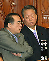 October 28, 2011, Tokyo, Japan - Ichiro Ozawa, right, a Democratic Party of Japan stalwart, speaks to Hiroshi Nakai, former chairman of the National Public Safety Commission, during a plenary session of Diet's lower house in Tokyo on Friday, October 28, 2011. Ozawa has been charged with violation of the political funds control law, to which he pleaded not guilty. (Photo by Natsuki Sakai/AFLO) [3615] -mis-
