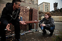 Sergei and Masha, a 19-year-old mother, drink beer at the polar midnight in the nickel-producing town of Zapolyarna. Sulphur dioxide emitted from the factory has killed vegetation, polluted ground water and causes asthma, especially among children. /Felix Features