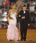 Junior maid Alex Tuft is escorted by John Mills at Lafayette High vs. Lewisburg in Homecoming football action in Oxford, Miss. on Friday, September 30, 2011.