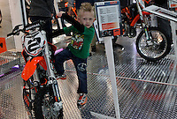 A boy visit the International motorcycle show in New York, United States. 18/12/2013. Photo by Kena Betancur/VIEWpress.