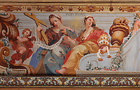 Detail of Sacra Pagina or Theology, from the allegorical trompe l'oeil ceiling fresco painted by Antonio Simoes Ribeiro and Vicente Nunez, in the Black Room of the Joanina Library, or Biblioteca Joanina, a Baroque library built 1717-28 by Gaspar Ferreira, part of the University of Coimbra General Library, in Coimbra, Portugal. The Casa da Livraria was built during the reign of King John V or Joao V, and consists of the Green Room, Red Room and Black Room, with 250,000 books dating from the 16th - 18th centuries. The library is part of the Faculty of Law and the University is housed in the buildings of the Royal Palace of Coimbra. The building is classified as a national monument and UNESCO World Heritage Site. Picture by Manuel Cohen