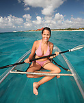 Girl in clear kayak off beach club west coast Cozumel