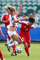 Korea DPR's KIM Un Yu beats USA's Kristie Mewis. USA v Korea Republic. FIFA U-17 Women's World Cup Final. North Harbour Stadium, Auckland, Sunday 16 October 2008. Photo: Simon Watts/PHOTOSPORT