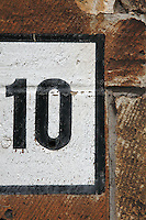 BRUGES, BELGIUM - FEBRUARY 08 : A detail of a street number painted on the stones on February 08, 2009 in Bruges, West Flanders, Belgium. (Photo by Manuel Cohen)
