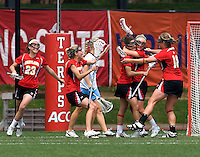 Katie Schwarzmann (7) and Kristy Black (8) and Karri Ellen Johnson (18) of Maryland celebrate a goal during the ACC women's lacrosse tournament finals in College Park, MD.  Maryland defeated North Carolina, 10-5.