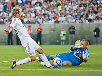 LOS ANGELES, CA – July 16, 2011: Fabio Coentrao (15) of Real Madrid and LA Galaxy goalie Josh Saunders (12) during the match between LA Galaxy and Real Madrid at the Los Angeles Memorial Coliseum in Los Angeles, California. Final score Real Madrid 4, LA Galaxy 1.