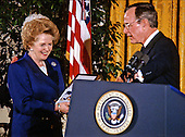 United States President George H.W. Bush, right, awards the Presidential Medal of Freedom, the highest civilian honor awarded by the U.S., to former Prime Minister Margaret Thatcher of Great Britain, left,  in the East Room of the White House in Washington, D.C. on March 7, 1991.  .Credit: Howard L. Sachs / CNP