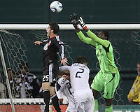 Santino Quaranta (25) of D.C. United goes up for a high ball against Donovan Ricketts (1) of the Los Angeles Galaxy during an MLS match at RFK Stadium, on April 9 2011, in Washington D.C.The game ended in a 1-1 tie.
