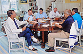 United States President George H.W. Bush meets with senior advisors to discuss the fiscal year 1991 budget and the costs of the Persian Gulf conflict at his home at Walkers Point in Kennebunkport, Maine August 22, 1990.<br /> Mandatory Credit: Carol T. Powers / White House via CNP