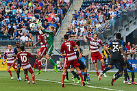 Goalkeeper Zac MacMath (18) of the Philadelphia Union spills the ball as he collides with London Woodberry (21) of FC Dallas. The Philadelphia Union and FC Dallas played to a 2-2 tie during a Major League Soccer (MLS) match at PPL Park in Chester, PA, on June 29, 2013.