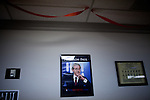 A signed portrait of Rep. Ron Paul hangs on the wall of his presidential campaign headquarters in Reno, Nev., January 31, 2012.