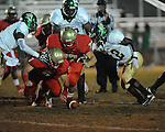 Lafayette High's Alec Michael (7) recovers a fumble as teammate Lafayette High's John Chance (77) moves in vs. Tunica Rosa Fort in Oxford, Miss. on Friday, October 5, 2012. Lafayette High won 35-6.