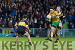 Luke Quinn Dr. Crokes in action against Michael Farragher Corofin in the Semi Final of the Senior Football Club Championship at the Gaelic Grounds, Limerick on Saturday.