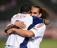 CARSON, CA - May 19, 2012: Real Salt Lake forward Devon Sandoval (49) congratulates Joao Plata (8) on his goal during the Chivas USA vs Real Salt Lake match at the Home Depot Center in Carson, California. Final score, Chivas USA 1, Real Salt Lake 4.