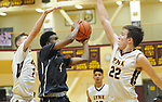 Eagle River's Daniel Toribio weaves his way for a shot through Dimond defenders Nicolas Horning and Nolan Heim.  Photo for the Star by Michael Dinneen