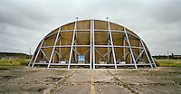 Deserted fighterplane shelter at a nuclear weapons storage site used by the American Air Force during the Cold War in Alconbury, Cambridgeshire. CHECK with MRM/FNA