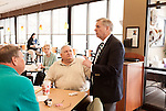 March 26, 2013. Lexington, South Carolina. On his way to meet with a local mayor, Sen. Lindsey Graham stopped by a Chick-fil-A to get some lunch and talk to customers, including Lloyd Loper, center.. Sen. Lindsey Graham, R- South Carolina, is up for reelection in 2014. He spent some time talking to his base back home about issues such as immigration reform as he readies himself for his campaign run..