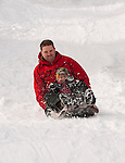 California, Lake Tahoe: Child and father enjoy snow play with sled at North Lake Tahoe Regional Park.  Photo copyright Lee Foster.  Photo # cataho107633