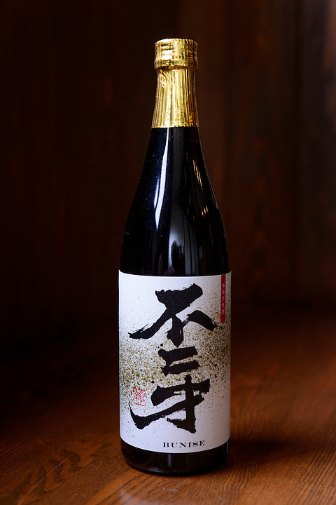 Shochu sold by Sata Souji Shoten Shochu Distillery, Minami Kyushu, Kagoshima Pref, Japan, December 21, 2016. The Sata Souji Shoten Shochu Distillery makes shochu spirits from local sweet potatoes. In recent years the distillery has imported grappa, brandy, calvados stills from Europe to experiment with new distilling techniques. They have attracted considerable attention from the media and other distillers as leading innovators in their industry.