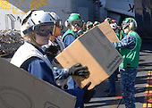 Sailors assigned to the aircraft carrier USS Ronald Reagan (CVN 76) and embarked Carrier Air Wing 14 take boxes off of a C-2A Greyhound from Fleet Logistics Combat Support Squadron (VRC) 30 on Tuesday, November 9, 2010.  Ronald Reagan was diverted from its current training maneuvers at the direction of Commander U.S. Third Fleet, and at the request of the U.S. Coast Guard, to a position south near the Carnival cruise ship C/V Splendor to facilitate the delivery of 4,500 pounds of supplies to the cruise ship.  Early Monday, CV Splendor reported it was dead in the water 150 nautical miles southwest of San Diego. .Mandatory Credit: Haldane Hamilton / U.S. Navy via CNP