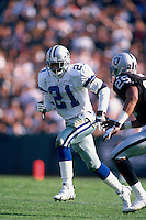 OAKLAND, CA - Deion Sanders of the Dallas Cowboys in action during a game against the Oakland Raiders at the Oakland Coliseum in Oakland, California in 1995. Photo by Brad Mangin