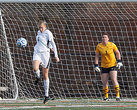 College of St Rose forward Molly Harpster (9) works to clear ball.. In 2012 NCAA Division II Women's Soccer Championship Tournament First Round, College of St Rose (white) defeated Wilmington University (black), 3-0, on Ronald J. Abdow Field at American International College on November 9, 2012.