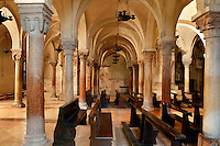 Low angle view of the columns in the crypt of the Basilica di San Zeno, 10th-14th centuries, Verona, Italy. This Romanesque church which forms the pattern for Verona's Romanesque style was constructed in 967 but damaged by an earthquake in 1117 and restored and enlarged from 1138 to 1398. Picture by Manuel Cohen.