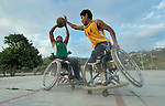 Alejandro Jarquin tries to shoot the basketball while Roel Hernandez attempts a block during practice in Zipolite, a town in Oaxaca, Mexico. Jarquin and Hernandez are part of the Oaxaca Costa wheelchair basketball team.