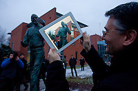 Viewer takes a photo with an iPad after the inauguration ceremony of the first ever life-size bronze statue of late Apple leader Steve Jobs in Budapest, Hungary on December 21, 2011. ATTILA VOLGYI